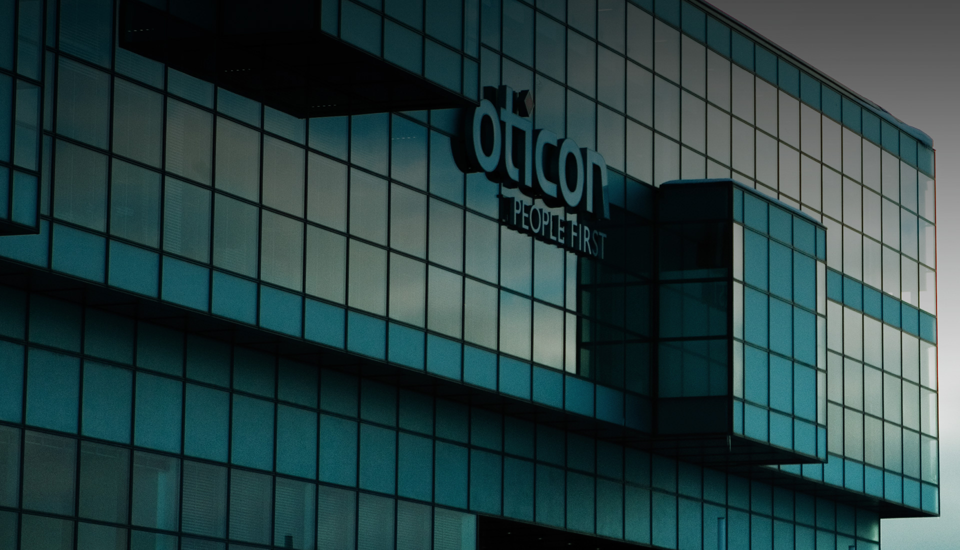 Oticon People First logo on building-1920x900