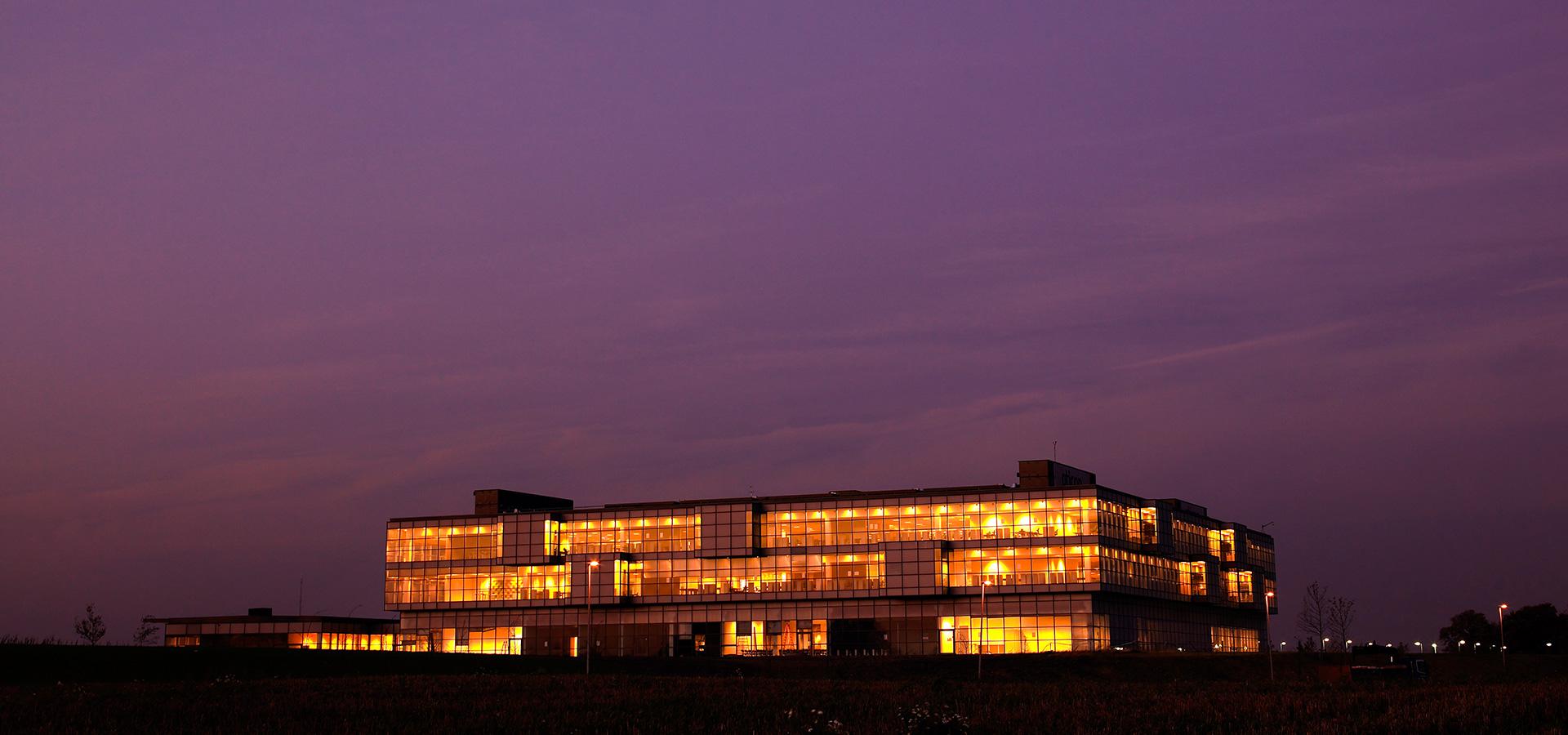 Oticon Denmark global headquarters building at night