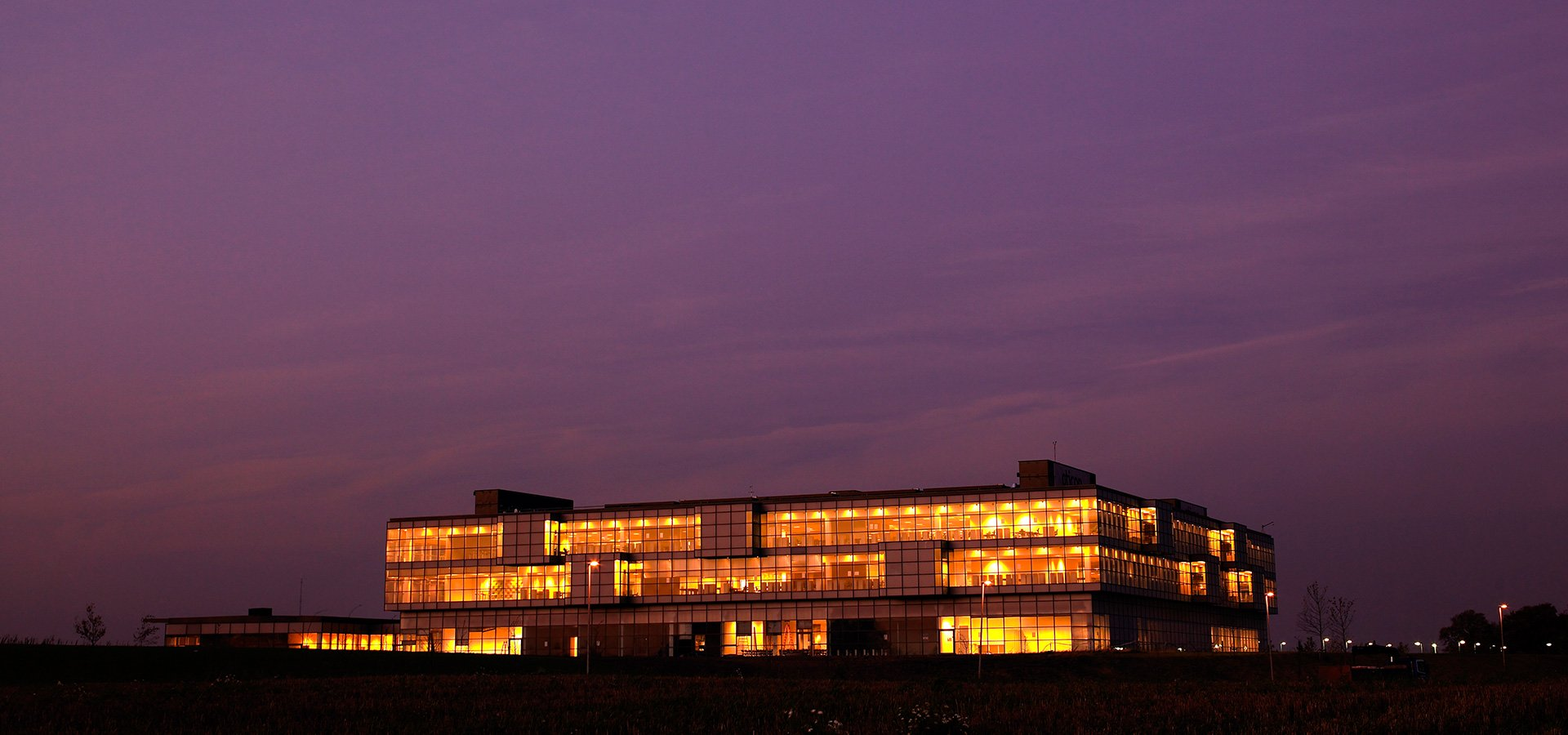 Oticon Denmark global headquarters building at night