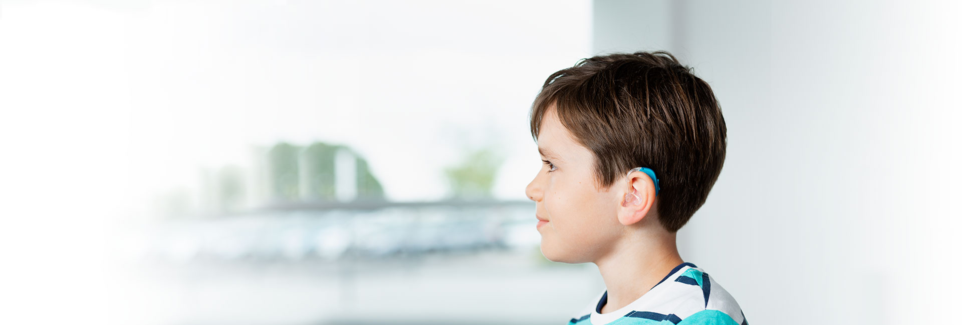Child wearing Oticon pediatric hearing aids