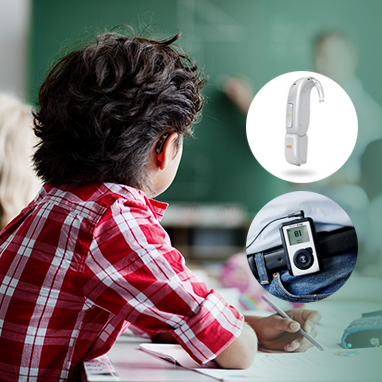 Child with amigo FM system and hearing aid