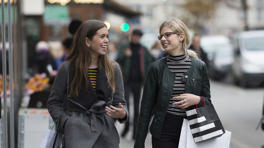 two teens walking down street with connectclip