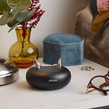 rechargeable hearing aid solution on night stand