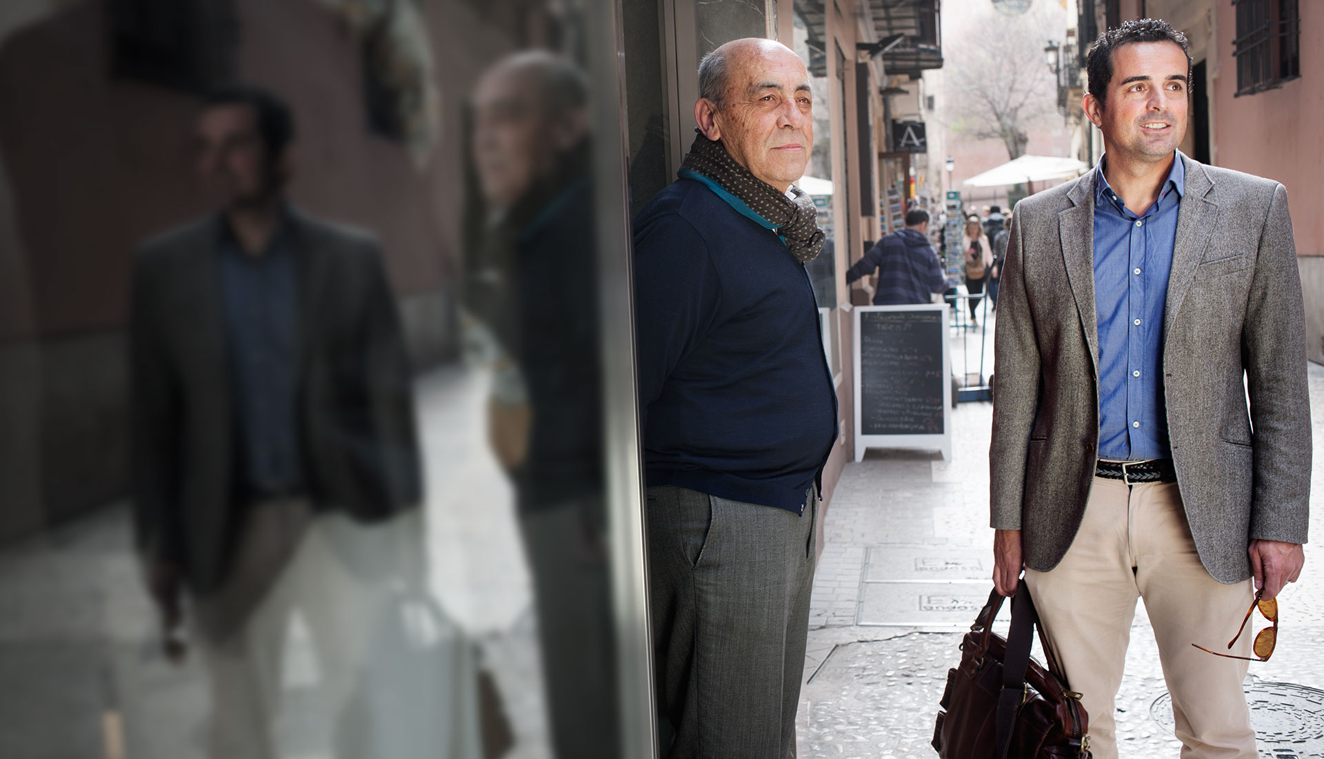 two men standing in the street