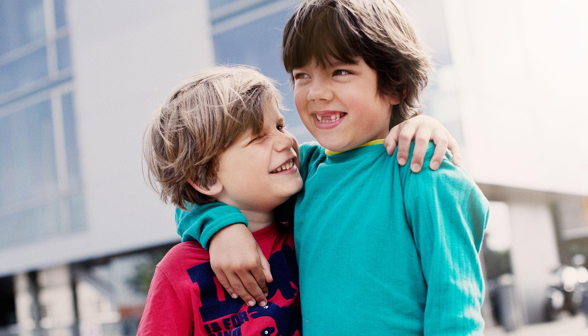 young boys hugging